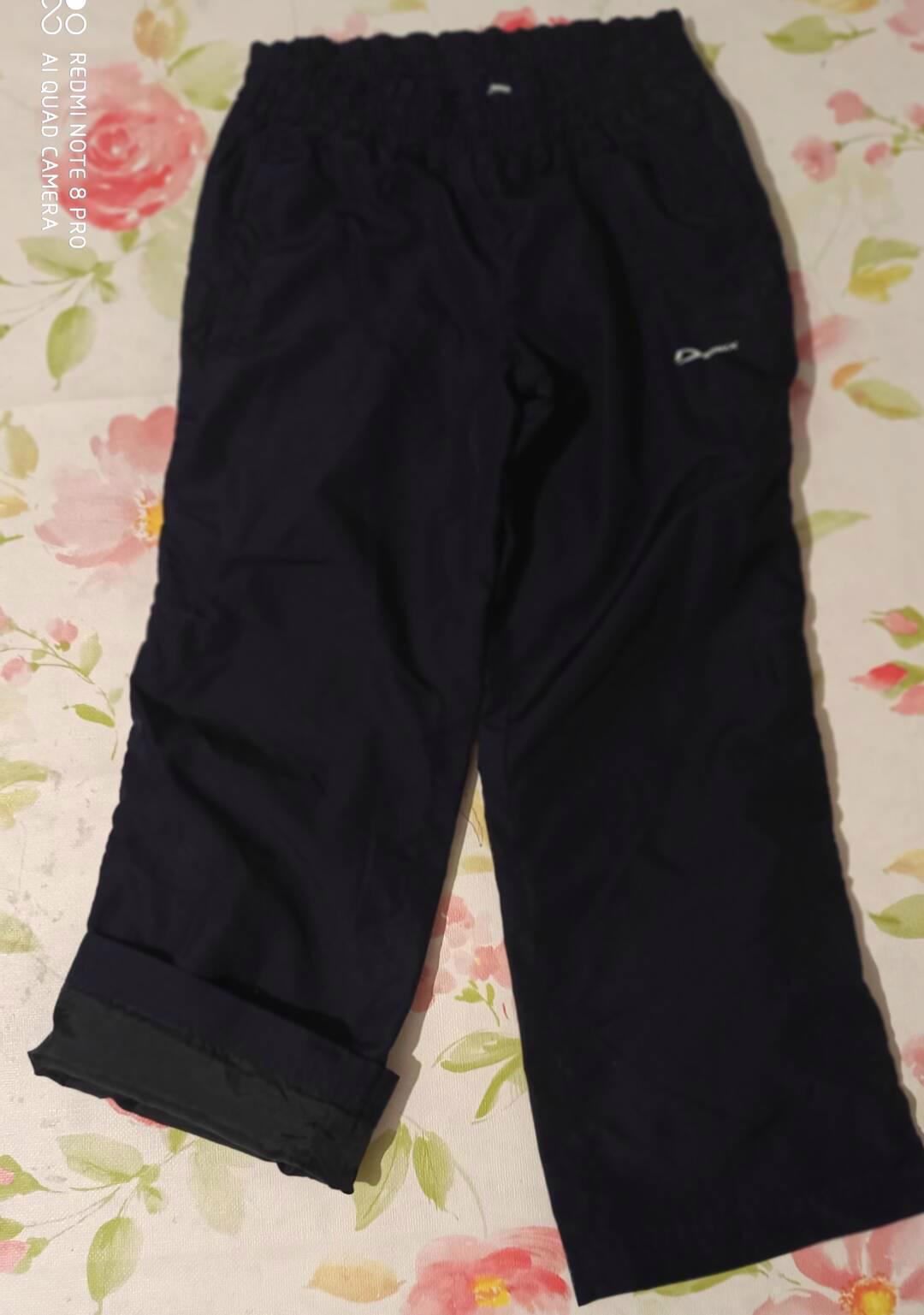 Nepromokavé svrchní kalhoty vel 110.  - foto 1