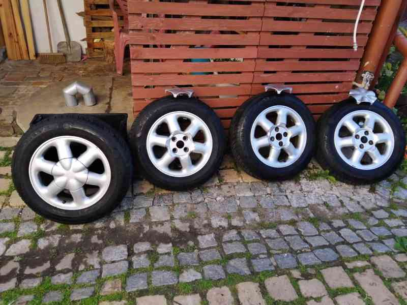 prodám letní pneu s elektrony Dunlop SP Response2 185/65/R 15 rozteč 100 mm - foto 1