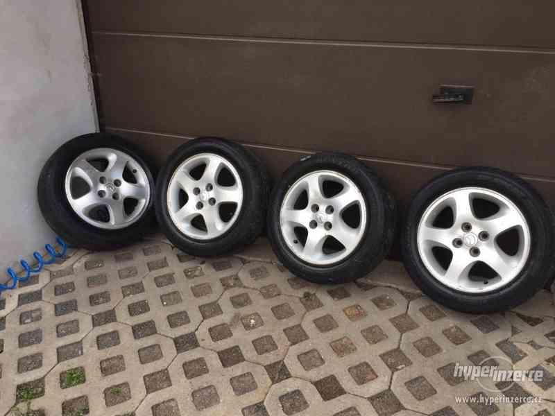 """Alu 15"""" Mazda,Ford 4x100 s Pneu"""