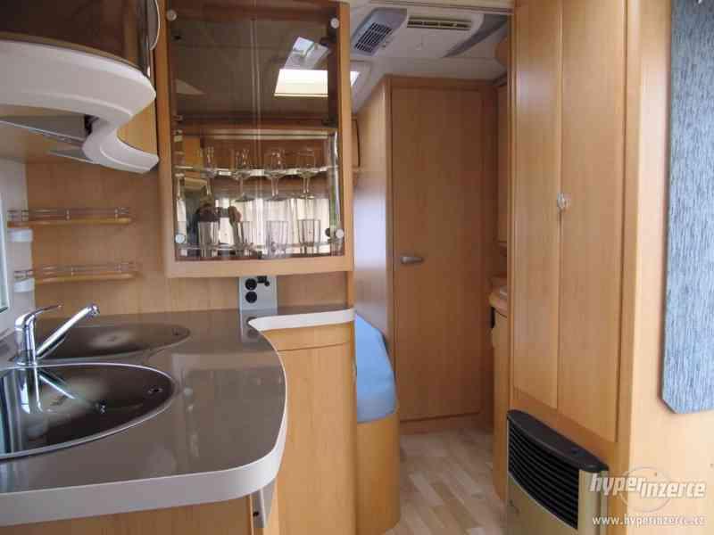 Prodám karavan Hobby 460 ufe,model 2008 + klima + před stan. - foto 11