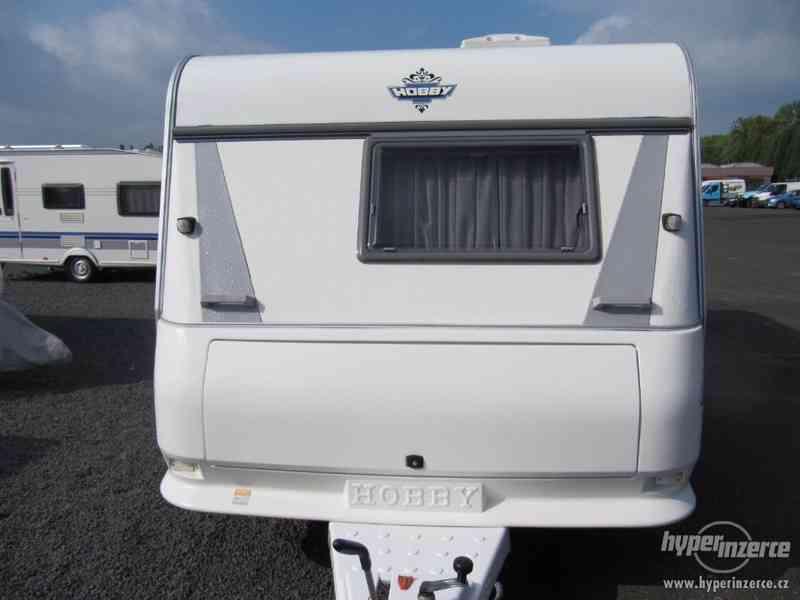 Prodám karavan Hobby 495 ufe,r.v.2002 + před stan.
